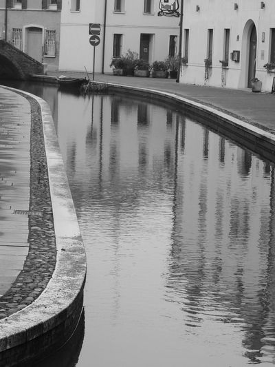 Architecture Black And White Blackandwhite Blackandwhite Photography Building Exterior Built Structure Canal City City Life Comacchio Comacchiocity Comacchiolidi Comacchiopiccolavenezia Comacchiosagradellanguilla Day Famous Place Mode Of Transport No People Outdoors Reflection River Transportation Travel Destinations Water Waterfront