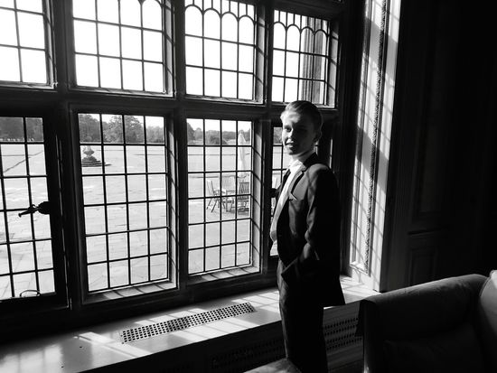 The Lord Of All He Surveys Indoors  Window Young Adult Well-dressed Contemplation Glass - Material Window Frame Thornton Hough Thornton Manor Wirral Lord Of All He Surveys Son Monochrome Photography