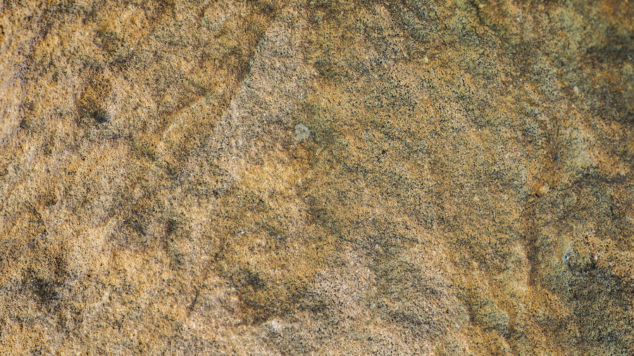 The Background Is Stone. Abstract Backgrounds Architecture Backgrounds Bad Condition Brown Built Structure Close-up Day Engraved Stones Full Frame Nature No People Old Outdoors Pattern Rock Rock - Object Rough Solid Textured  Textured Effect Wall - Building Feature Weathered