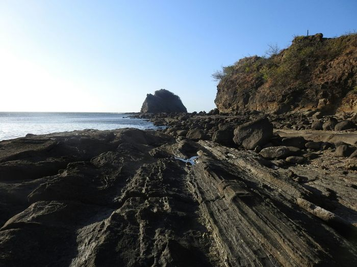 Costa Rica Guanacaste  Playa Rajada Sea Beach Water Cliff Rock - Object Sunlight Sky Horizon Over Water Rock Formation Geology