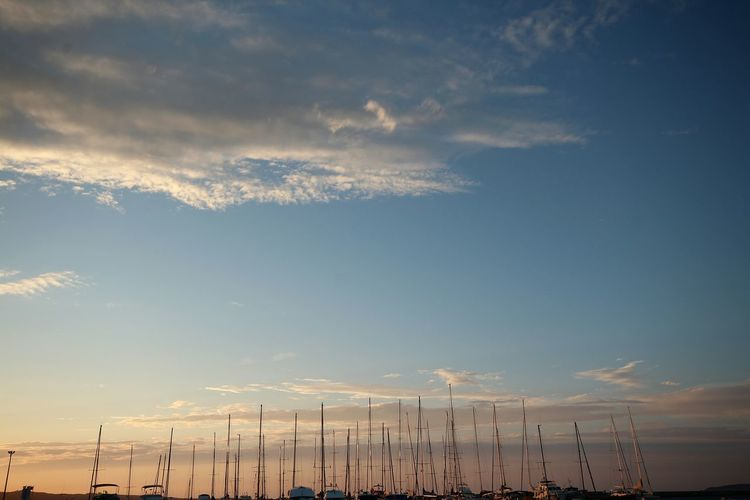 Low Angle View Of Sky Over Moored Boats