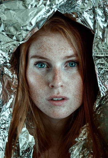 Creative Fine Art Portrait of a Woman Aluminium Foil Blue Eyes Fine Art Photography Portrait Of A Woman The Creative - 2018 EyeEm Awards The Portraitist - 2018 EyeEm Awards Available Light Beautiful Woman Beauty Canon EOS 750D Close-up Creative Female Freckles Front View Ginger Human Face Indoor Looking At Camera Model One Person Sigma 30mm/1.4 Art Young Adult