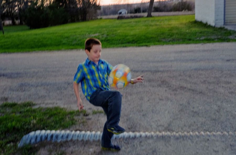 Visual Journal April 2017 Village of Western Nebraska Ball Boys Casual Clothing Childhood Easter Sunday Elementary Age Everyday Lives EyeEm Gallery EyeEmBestPics Family Time Full Length Grandma's House Kids Being Kids Leisure Activity Lifestyles One Person Outdoors Photo Diary Playing Small Town Stories Soccer Soccer Ball Soccer Player Storytelling Visual Journal