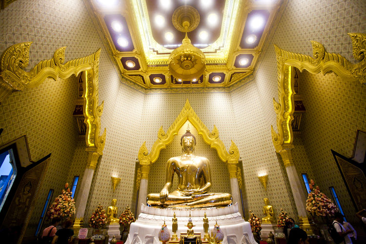 a Buddha image in a temple in Bangkok's Chinatown Architectural Feature Art Art And Craft Buddha Buddha Statue Buddhism Ceiling Close-up Creativity Full Frame Gold Gold Colored Golden Indoors  Interior Interiors Place Of Worship Religion Spirituality Temple Yellow