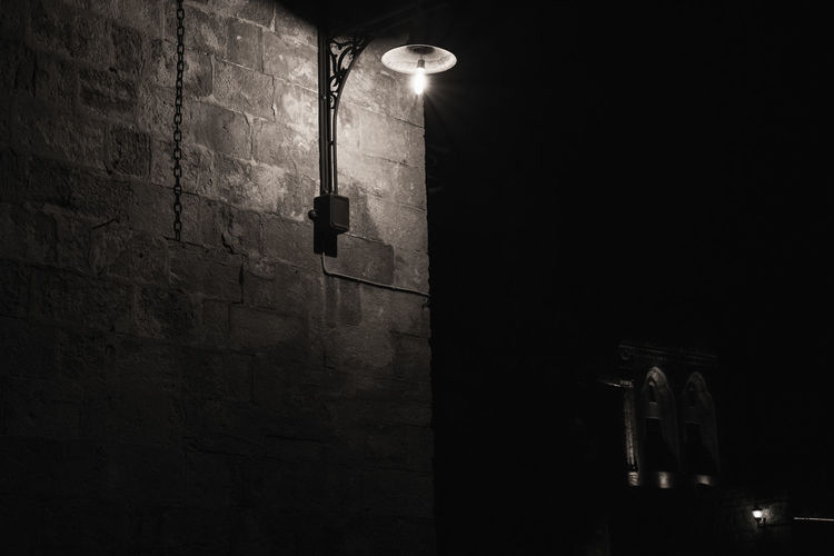 Illuminated Lighting Equipment Electricity  Built Structure Wall - Building Feature Low Angle View Architecture Light Wall Night No People Electric Light Brick Wall Street Light Street Brick Electric Lamp Building Exterior Glowing Dark Ceiling Light Fixture Electrical Equipment