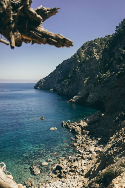 Cala De Sa Costa Brava Es Cuco Mallorca Beach Beauty In Nature Clear Sky Cliff Coast Day Mountain Nature No People Outdoors Rock - Object Scenics Sea Sky Spaın Tranquility Water
