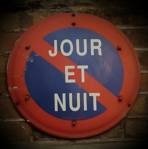 Blue Circle Close-up Communication Day French Sign Geometric Shape Guidance Jour Et Nuit No People Outdoors Red Road Sign Text Warning Sign Western Script