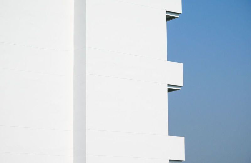 Architecture Built Structure Building Exterior Low Angle View Clear Sky Sky No People Building White Color Nature Day Copy Space Outdoors Wall - Building Feature Sunlight Industry Blue Factory City Geometric Shape Blank