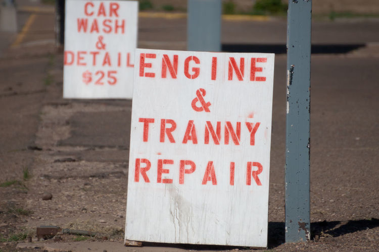 Engine repair sign Car Wash Close-up Communication Day Engine Repair Focus On Foreground Garage Garage Sign Information Information Sign No People Outdoors Red Red And White Signs Signs Text Western Script