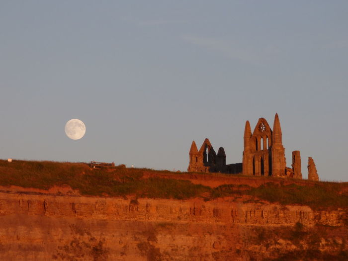 Full Moon at Whitby Abbey at Sunset Ancient Architecture Beauty In Nature Built Structure Day History Landscape Low Angle View Nature No People Outdoors Scenics Sky The Past Tourism Tranquil Scene Tranquility Travel Destinations