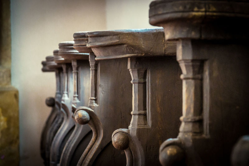 Close-up of benches in church