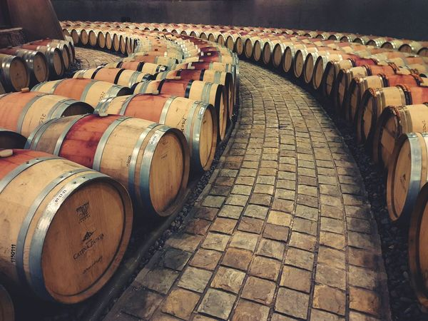 Wine Lifestyles EyeEm Selects In A Row Wine Cask Food And Drink Industry Barrel Abundance Wine Cellar Cellar No People Indoors  Day The Still Life Photographer - 2018 EyeEm Awards The Still Life Photographer - 2018 EyeEm Awards The Street Photographer - 2018 EyeEm Awards The Traveler - 2018 EyeEm Awards