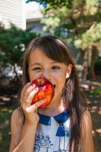 Apple Back To School Child Focus On Foreground Fruit Girls Healthy Eating Long Hair Outdoors Portrait