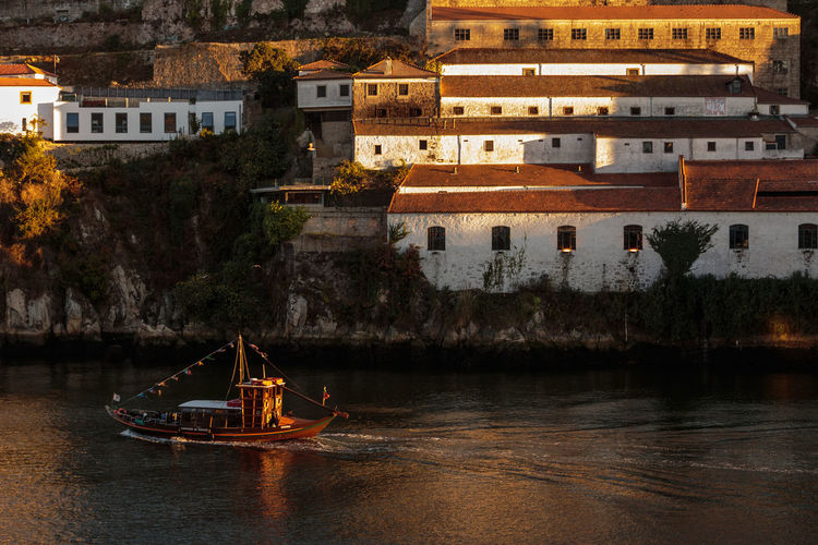 boat on Douro river. Vila Nova de Gaia. Portugal Douro  Portugal Vila Nova De Gaia Architecture Boat Building Exterior Built Structure City Day Galeno House Massimo Galeno Nature Nautical Vessel No People Outdoors River Travel Destinations Water