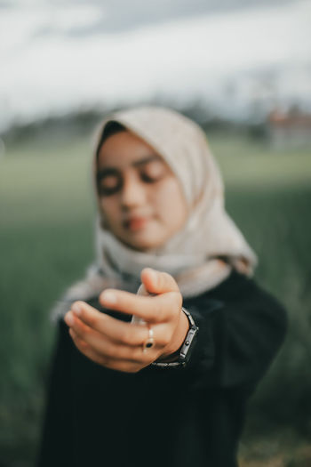 Portrait of a woman holding camera