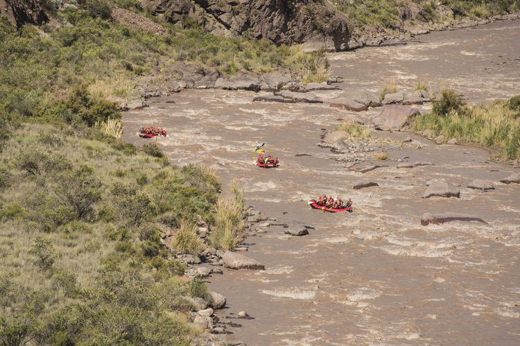 High angle view of people rafting in river
