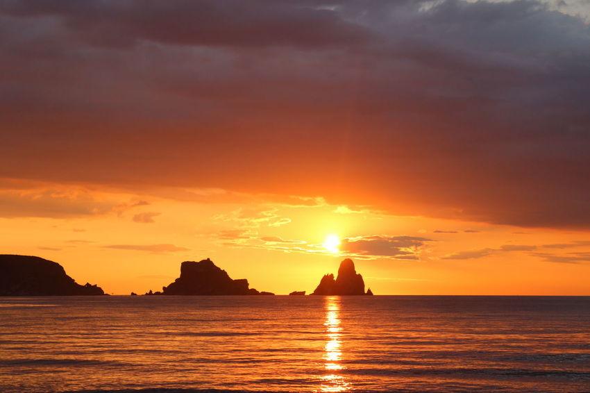 EyeEm Selects Sunset Sky Water Sea Cloud - Sky Scenics - Nature Travel Destinations Nature Tranquility Silhouette Land Nautical Vessel Sun Beauty In Nature Horizon Travel Horizon Over Water Tranquil Scene Environment Orange Color