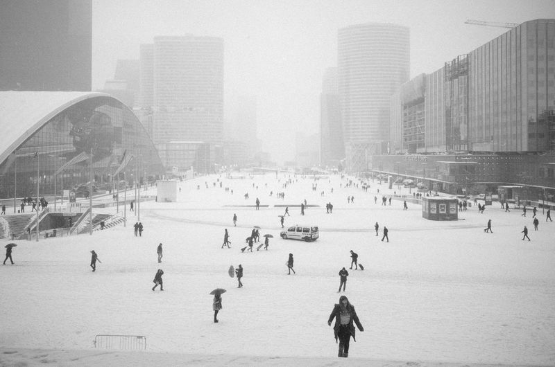 Group of people on snow in city