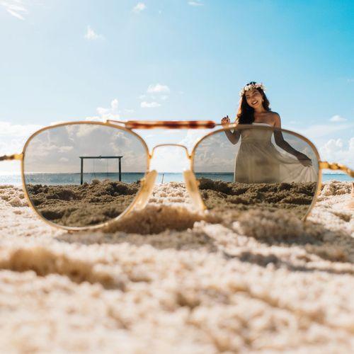 Woman on sand at beach against sky