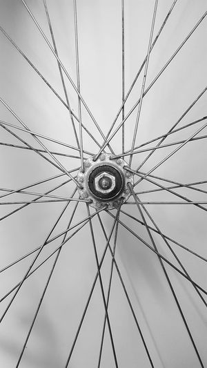 Close-Up Of Spoke By Wall