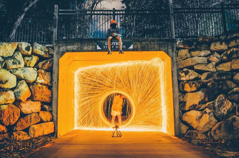 Man Standing By Wire Wool In Tunnel