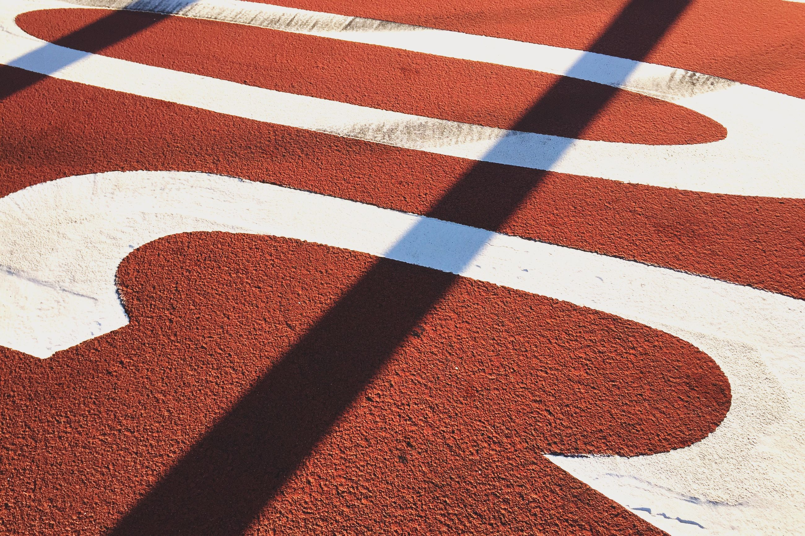 red, pattern, high angle view, full frame, textured, backgrounds, design, street, white color, multi colored, shadow, close-up, day, no people, road marking, sunlight, tiled floor, tile, outdoors, striped