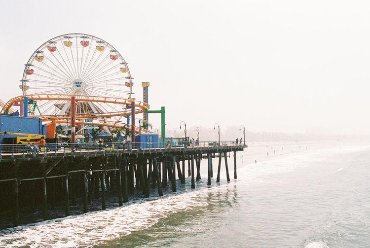 Santa Monica Pier - 35mm film Santa Monica Santa Monica Pier Amusement Park Architecture Beach Built Structure Clear Sky Copy Space Day Ferris Wheel Land Leisure Activity Nature No People Outdoors Pier Sea Sky Water