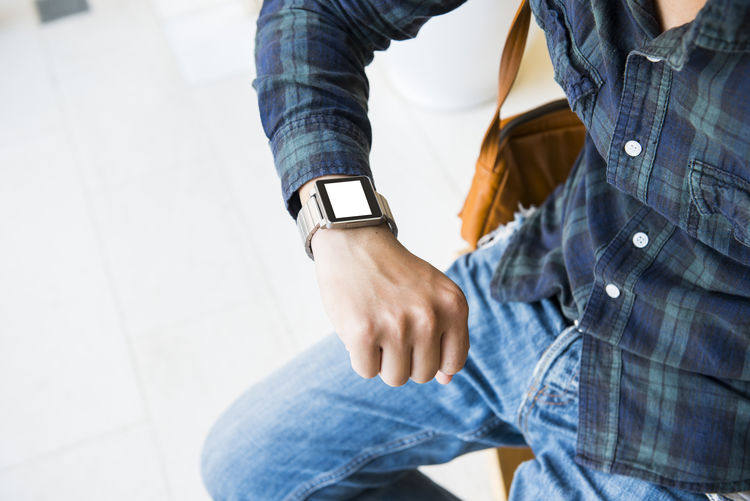 Smart Casual Clothing Day Denim Focus On Foreground Hand Human Body Part Human Hand Jeans Leisure Activity Lifestyles Men Midsection People Real People Smartwatch Standing Time Togetherness Two People Wristwatch