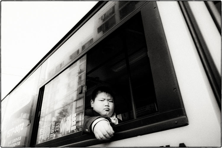 My second post since starting my EyeEm account anew. I took this walking from my house to work in Iksan, South Korea. I took 6 or 7 photos of this kid and he never flinched. ASIA Documentary Photography EyeEm Best Shots EyeEm Korea EyeEmNewHere Korea Buyfilmnotmegapixels Filmisnotdead Jtinseoul Kid Monochrome Portrait Ricoh Street Photography Streetphoto_bw first eyeem photo EyeEm Ready