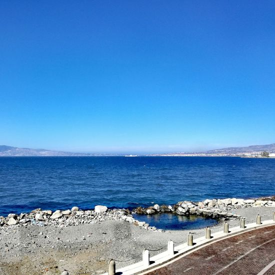 Blue Sea Water Horizon Over Water Clear Sky Sky Beach Day No People Outdoors Scenics Tranquility Beauty In Nature Nature Tranquil Scene Sand Landscape Landscape_Collection Straitofmessina Strait Of Messina View Promenade Skyscape Calabria Huawei P9 Lite
