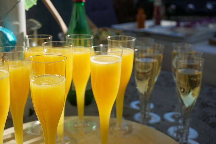 Close up of  glasses with mimosa drinks