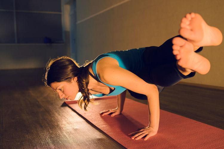 Woman exercising in yoga studio