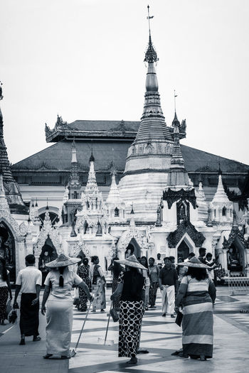 3 Women Adult Architecture Art Brushing Building Exterior Built Structure Cleaning Day Large Group Of People Myanmar Outdoors Pagoda People Real People Sky Statue Temple Travel Destinations Walking Around Women Yangon