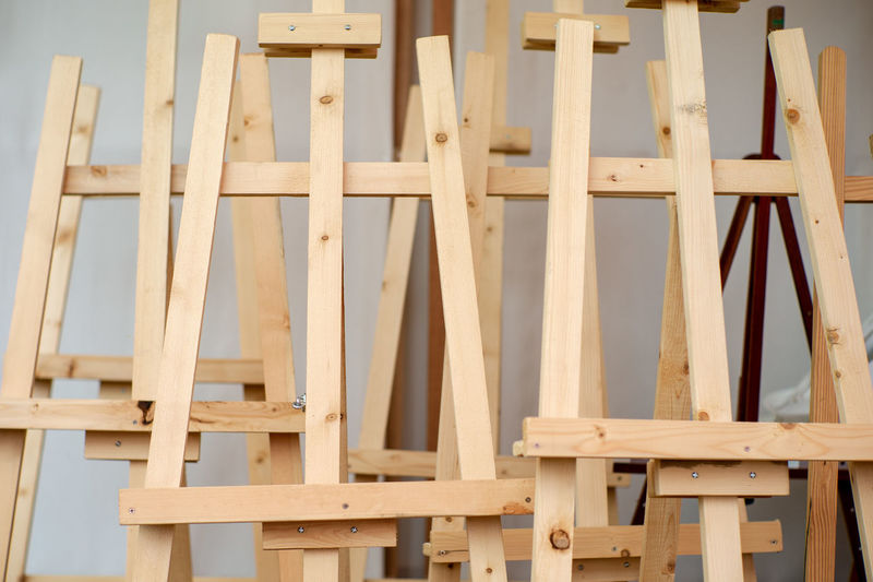 Empty wooden easel tripod for painting canvas