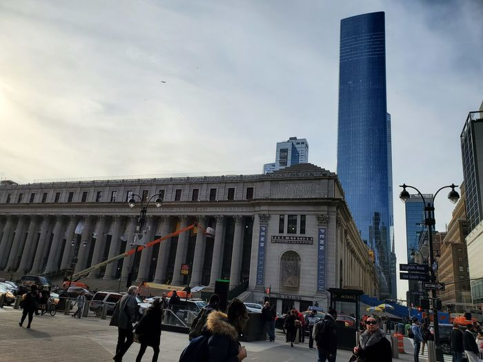 Group of people in city against sky
