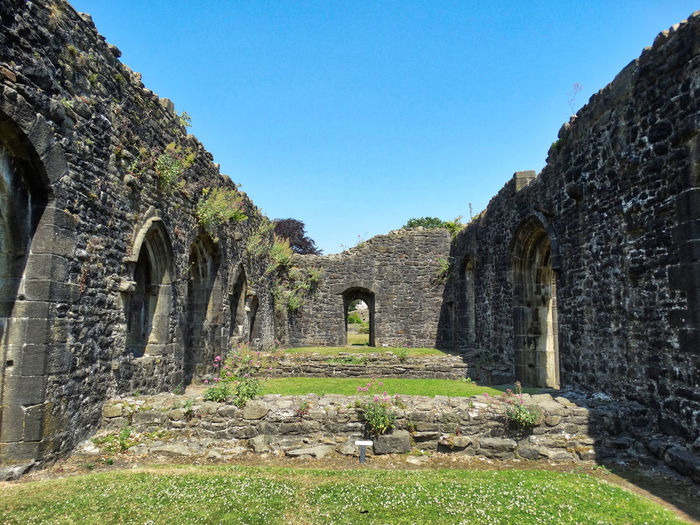 Old Ruins in the sun. The Past History Architecture Built Structure Sky Ancient Old Ruin Day Nature No People Old Ancient Civilization Grass Plant Clear Sky Arch Travel Destinations Travel Building Exterior Tourism Ruined Archaeology Outdoors Stone Wall