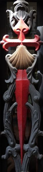 Cross of St. James in iron (part of a door frame). The seashell is the symbol of the completed pilgrimage St. James Cross Pilgrim Pilgrimage Christianity Religion Christian Red Close-up No People Pattern Creativity Design Art And Craft