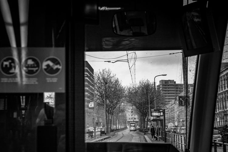 Blackandwhite Den Haag Street Framed Looking Out Of The Window Mode Of Transport Nikonphotography Rainy Day Street Scene Streetphotography Tram Urbanphotography Feel The Journey Urban Exploration