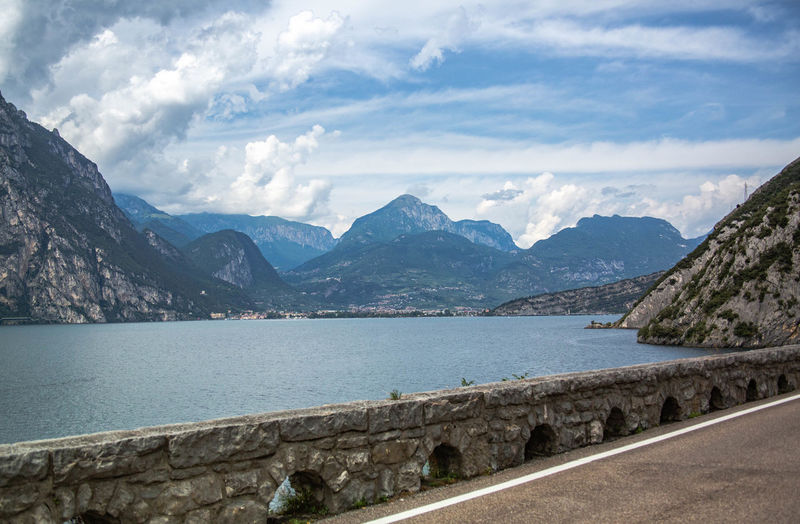 Scenic view of lake and mountains against sky at lake garda italy