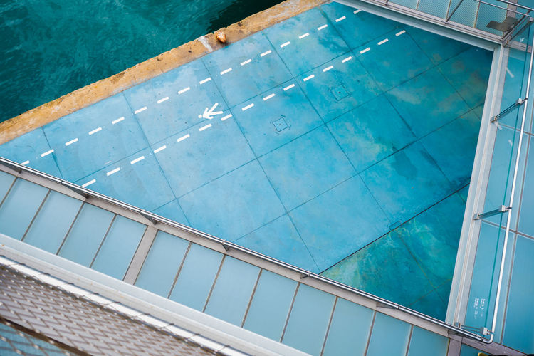 Architecture Blue Building Building Exterior Built Structure Day Glass - Material High Angle View Modern Nature No People Outdoors Pool Reflection Swimming Pool Transparent Turquoise Colored Water