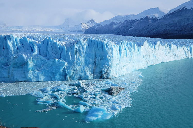 Perito Moreno Glacier Patagonia Argentina Argentina Landscape Scenics Perito Moreno. Patagonia. Argentina. Hike Trek Still Blue Sky Beauty In Nature Ice Water Snow Cold Temperature Sea Winter Beauty Mountain Glacier Frozen Water Physical Geography Natural Landmark Rugged Snowcapped Mountain Dramatic Landscape