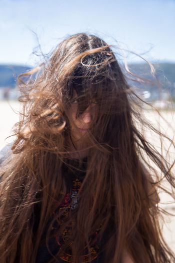 Portrait of brunette girl with long flying hair in the wind outdoors. Young casual woman with wavy hair covering her face. Teenage girl with messy windy tousy blowsy hair. Long Hair Hairstyle Hair Brown Hair One Person Women Portrait Wind Headshot Tousled Hair Day Human Hair Nature Outdoors Teenager Clutter Joyful Carefree Jumble Chaos Disorder Windy Beauty Contemplation Beautiful Woman My Best Photo My Best Photo
