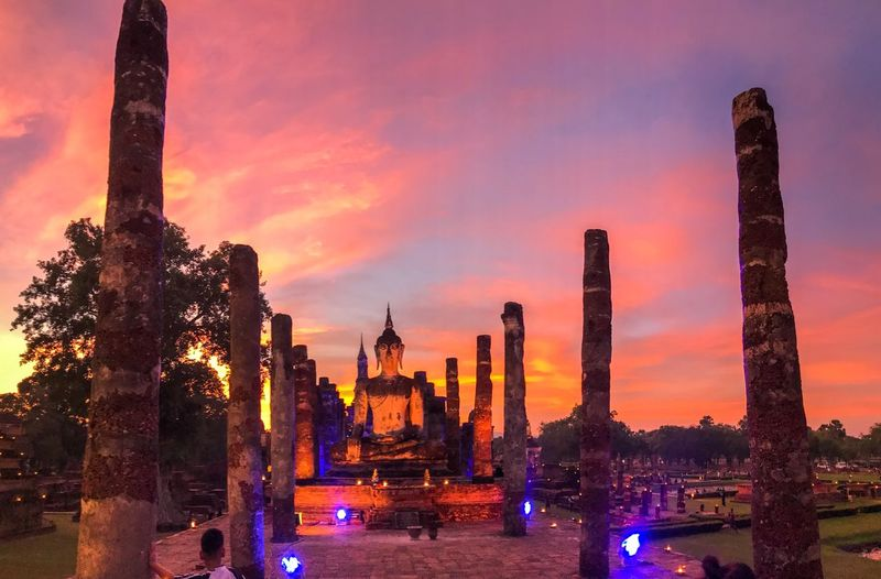Panoramic view of illuminated buildings against sky during sunset