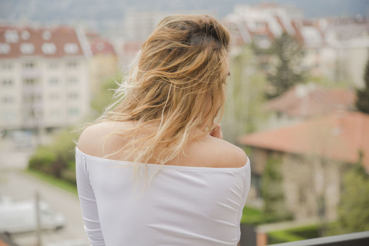 Rear View One Person Focus On Foreground Blond Hair Hair Lifestyles Architecture Hairstyle Real People Adult Building Exterior Standing Built Structure Women Day Leisure Activity Young Adult Long Hair Young Women Outdoors Human Hair Beautiful Woman Looking At View