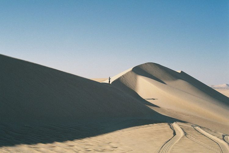 Film Travel Beauty In Nature Blue Clear Sky Climate Day Desert Environment Film Photography Land Landscape Nature No People Outdoors Sand Sand Dune Scenics - Nature Sky Sunlight Tranquil Scene Tranquility