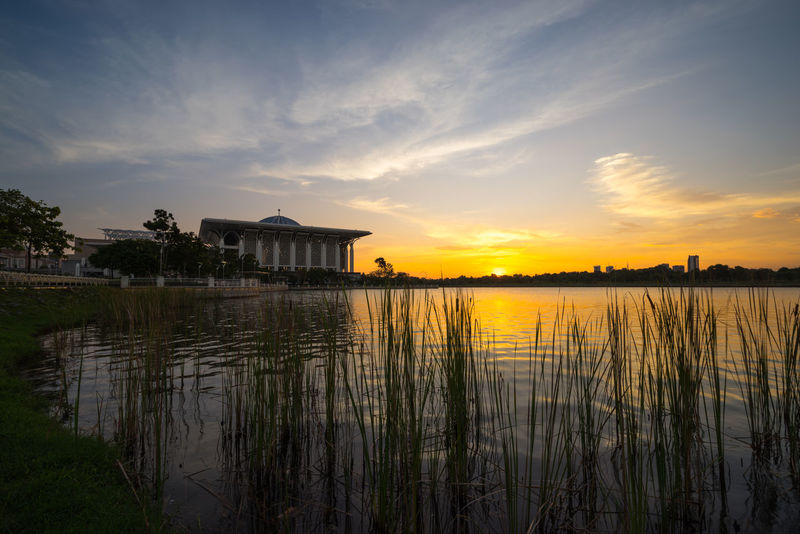 Sunset over Tuanku Mizan Zainal Abidin Mosque. Also known as Iron Mosque, the Mizan mosque is the second principal mosque in Putrajaya. Lake View Mosque Putrajaya,malaysia Relection On Water Sunset Silhouettes Tourism Tourist Attraction  Tranquility Travel Destinations