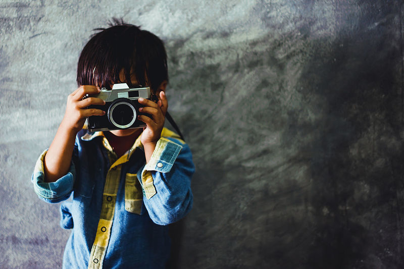 Picture of a boy holding a camera (The concept of photography is not complicated) Camera - Photographic Equipment Photography Themes Photographing Real People Technology Activity Lifestyles Camera Digital Camera Digital Single-lens Reflex Camera Portrait Photographer Cute Photography Photo Retro Boy Camera Photography Is My Escape From Reality!