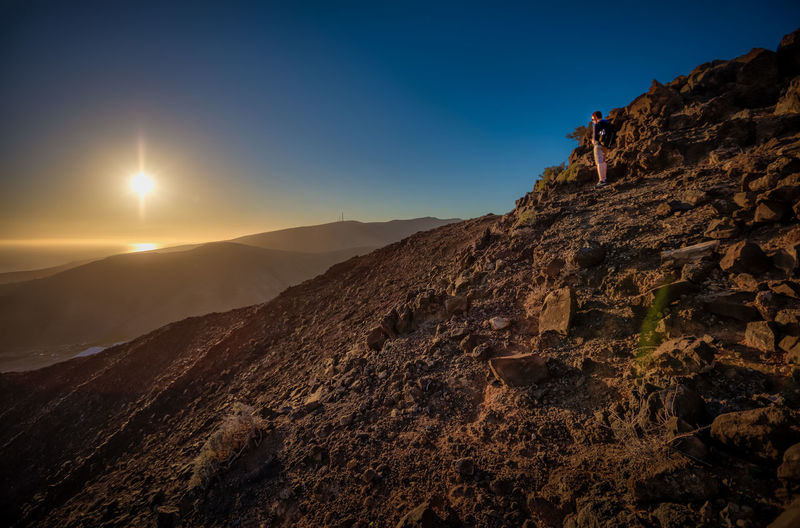 Lost in Landscape Fuerteventura Lost In The Landscape Nature Rock Beauty In Nature Beauty In Nature Clear Sky Day Mountain Nature No People One Men One Person Outdoors Sky Sun Sunset