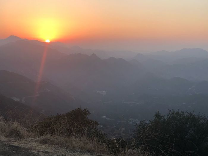 Fog Scenics - Nature Beauty In Nature Mountain Environment Sky Tranquility Mountain Range Sun Outdoors Sunset Tranquil Scene Landscape Orange Color