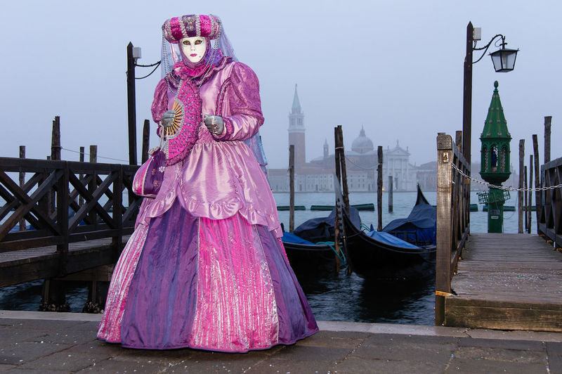 Carnival in Venice Canal Grande Carnival In Venice Pink Adult Architecture Built Structure Costume Day Down Full Length Gondola - Traditional Boat Mask - Disguise One Person Outdoors People Real People Sky Standing Venetian Mask Young Adult The Street Photographer - 2018 EyeEm Awards The Portraitist - 2018 EyeEm Awards